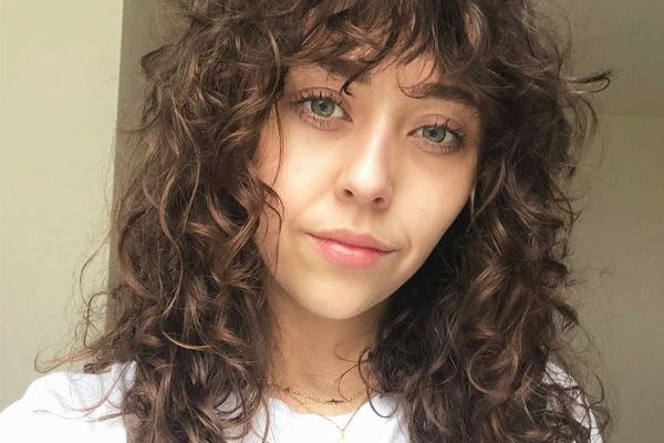 How To Wear Curly Hair With Bangs